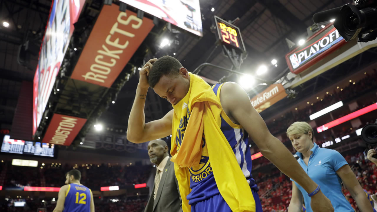 Golden State Warriors' Stephen Curry heads off the court and to the locker room at the start of the second half in Game 4 of a first-round NBA basketball playoff series against the Houston Rockets, Sunday, April 24, 2016, in Houston.