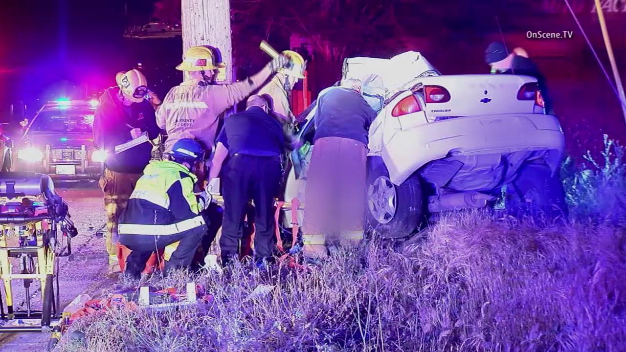 Los Angeles County sheriff's deputies investigate a fatal crash in the 23000 block of N. Sierra Highway in Santa Clarita on Tuesday, April 26, 2016.