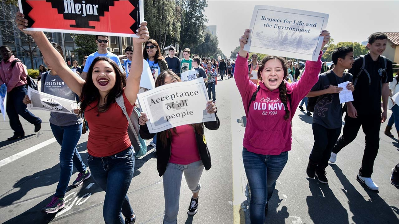Students and community members join in a symbolic march from the Saroyan Theatre to Fresno Adult School as part of the Cesar Chavez Day of Service and Learning March 17.
