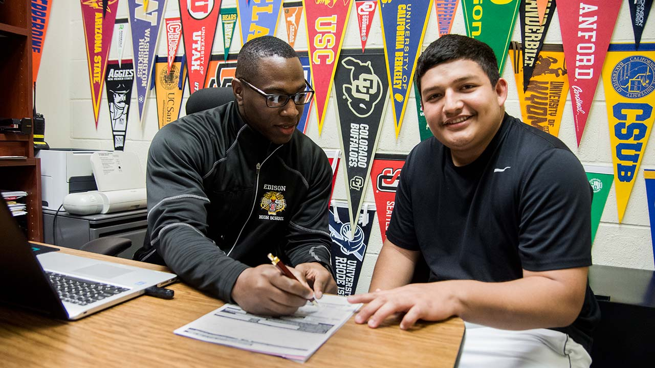 Edison High School senior Oscar Rivera, working with academic counselor Arthur Sulcer, walked 1,000 miles from his home in Honduras to the U.S.