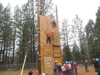 Yokomi Elementary School students try out the climbing wall at Sierra Outdoor School, where sixth graders traveled for camp earlier this year.