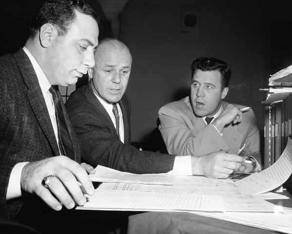 "<div class=""meta image-caption""><div class=""origin-logo origin-image ap""><span>AP</span></div><span class=""caption-text"">Draft choice list is checked closely by Green Bay Packers scout Jack Vainisi, left, Packers new head coach Ray McLean, center, assistant coach Jack Morton, Jan. 28, 1958 in Phila. (AP Photo/Bill Ingraham)</span></div>"