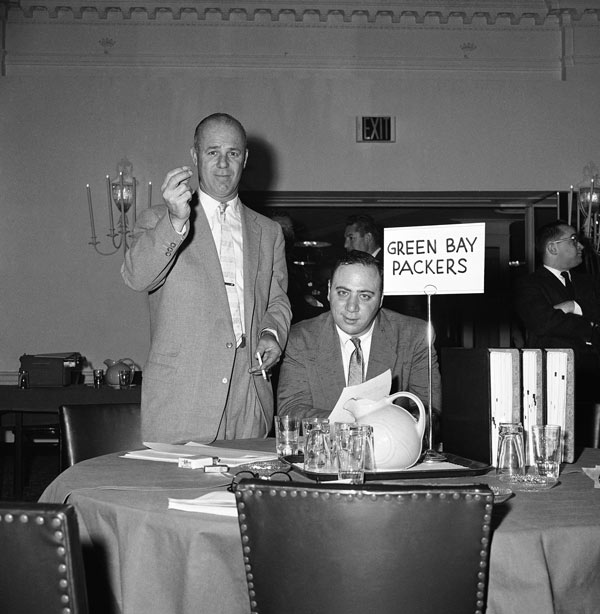 "<div class=""meta image-caption""><div class=""origin-logo origin-image ap""><span>AP</span></div><span class=""caption-text"">Ray McLean, left, Green Bay Packers coach, raises hand in gesture marking the first choice in the annual NFL player draft, Dec. 1, 1958 in Philadelphia. (AP Photo/Sam Myers)</span></div>"