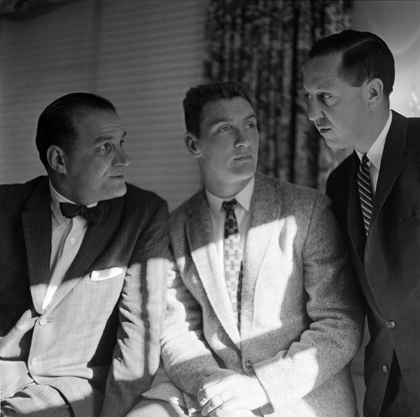 "<div class=""meta image-caption""><div class=""origin-logo origin-image ap""><span>AP</span></div><span class=""caption-text"">Billy Cannon, center, listens during conversation between Los Angeles Rams' coach Sid Gillman, left, and Ram's general manager Pete Rozrelle in Philadelphia, Pa., Nov. 30, 1959. (AP Photo)</span></div>"