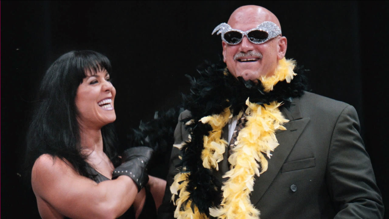 In this July 14, 1999, file photo, Minnesota Gov. Jesse Ventura stands with professional wrestler Chyna, during a World Wrestling Federation press conference in Minneapolis.