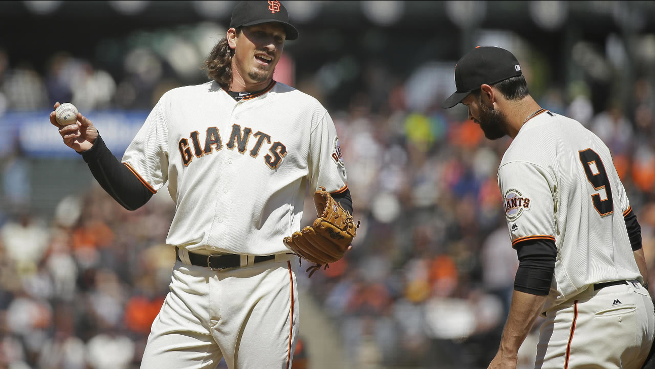 Giants' Jeff Samardzija laughs with Brandon Belt during a baseball game against the Padres in San Francisco on Wednesday, April 27, 2016. (AP Photo/Eric Risberg)