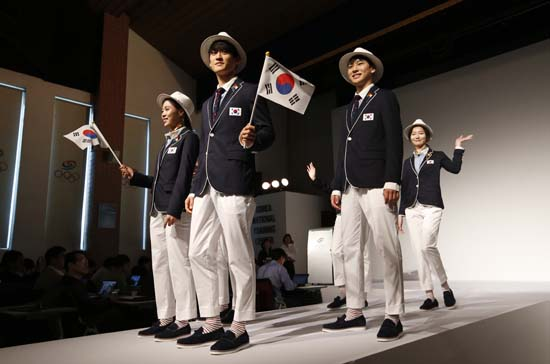 "<div class=""meta image-caption""><div class=""origin-logo origin-image ap""><span>AP</span></div><span class=""caption-text"">South Korean Olympic athletes and models present the South Korean Olympic team uniforms for the opening and closing ceremonies of the 2016 Rio de Janeiro Olympic Games (AP Photo/Lee Jin-man)</span></div>"
