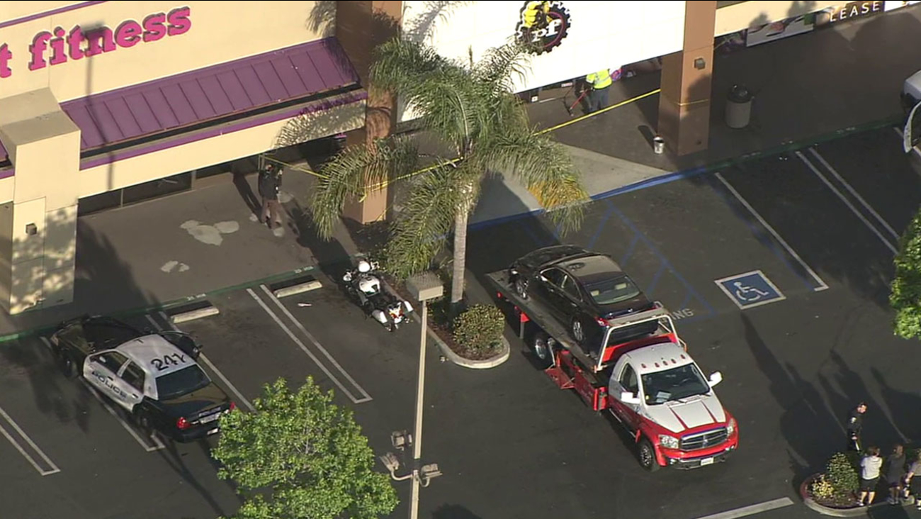 A tow truck removes a Lexus after the driver of the car crashed into a Torrance Planet Fitness gym, injuring five people, on Wednesday, April 27, 2016.