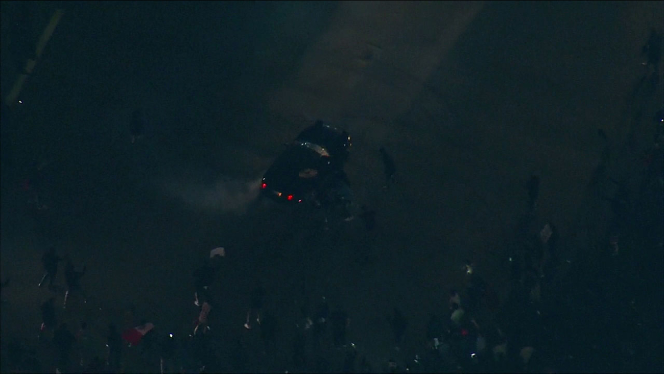 A car spun out wildly, doing doughnuts in the middle of a crowd outside the Donald Trump rally in Costa Mesa.
