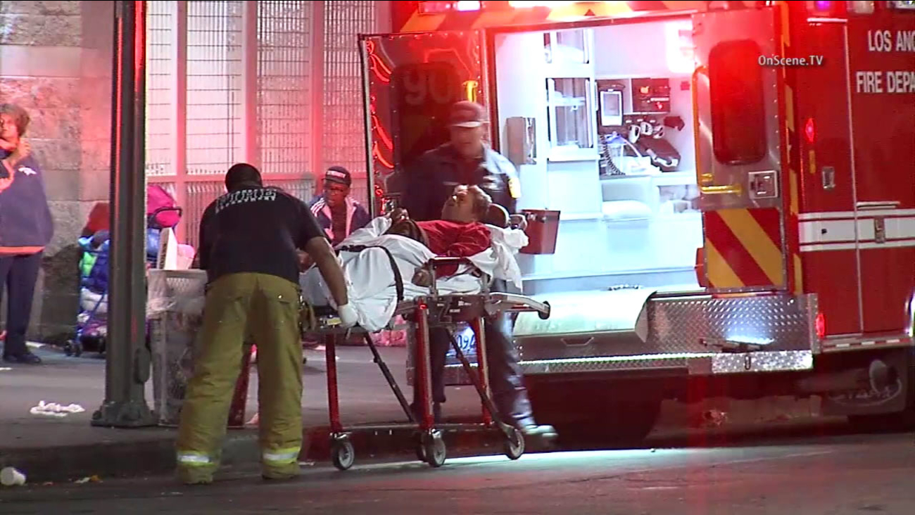 A patient is placed into an ambulance in Los Angeles' Skid Row area on Thursday, April 29, 2016.