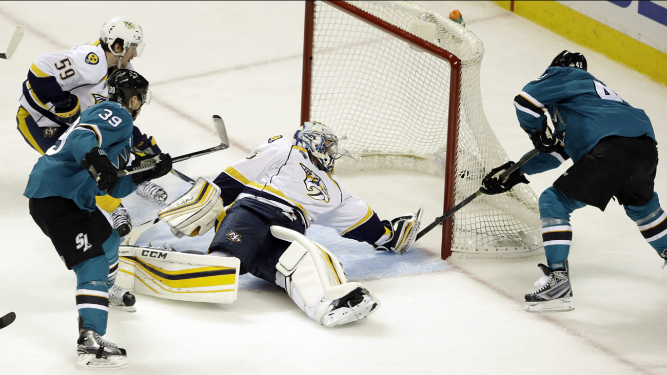 San Jose Sharks' Joel Ward, right, scores past Nashville Predators goalie Pekka Rinne during the third period of Game 1 in an NHL hockey Stanley Cup Western Conference semifinal.