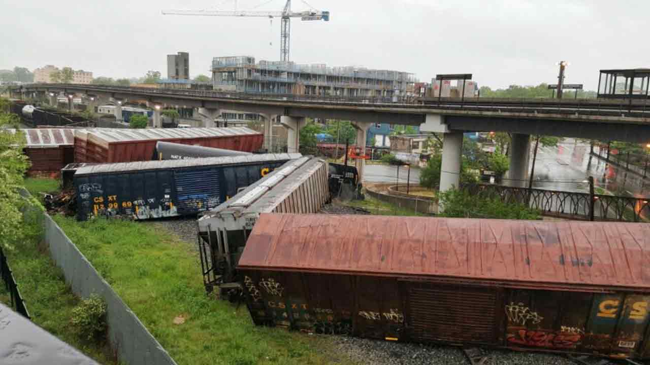 Several cars remain overturned after a CSX freight train derailed in Washington on Sunday, May 1, 2016.