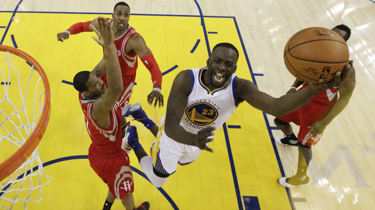 Warriors' Draymond Green drives past the Houston Rockets players in Game 5 of a first-round NBA basketball playoff series Wednesday, April 27, 2016, in Oakland, Calif.