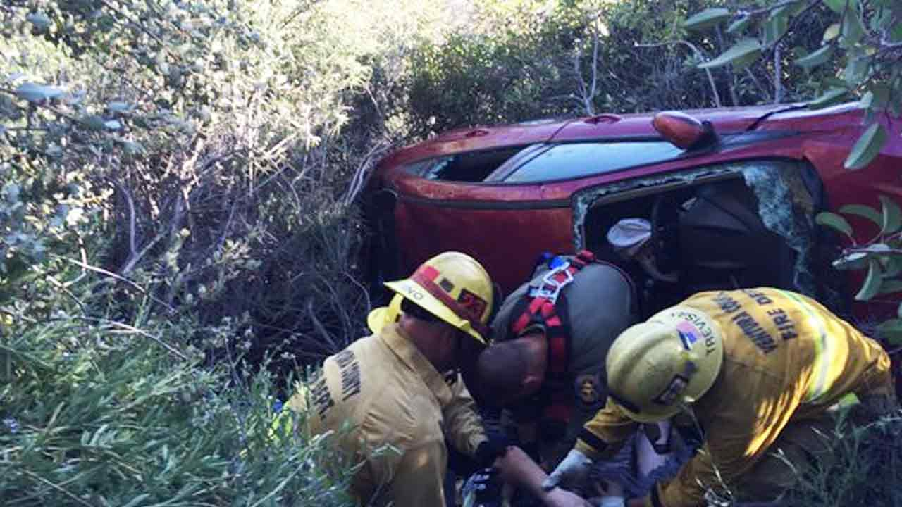 A high-speed chase suspect gets rescued by Ventura County rescue crews after driving over a cliff in Ojai, Calif., on Saturday, April 30, 2016.