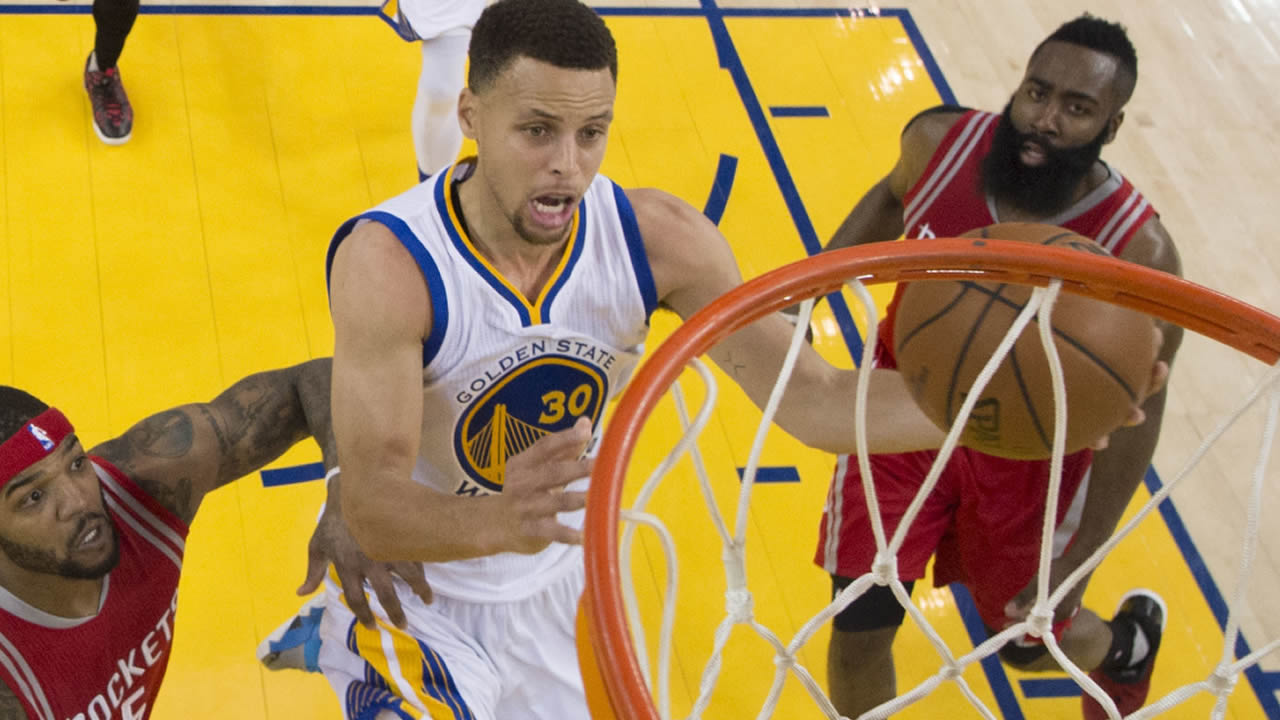Golden State Warriors' Stephen Curry, center, drives past Houston Rockets' Josh Smith, left, and James Harden, bottom right, during the first half in Game 1 of a first-round NBA basketball playoff series Saturday, April 16, 2016, in Oakland, Calif. (Kyle