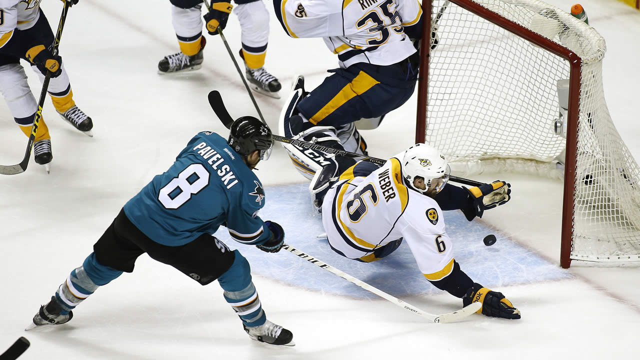 Sharks' Joe Pavelski scores a goal past Predators' Shea Weber during Game 2 in an NHL hockey Western Conference semifinal series on May 1, 2016, in San Jose, Calif. (AP Photo)