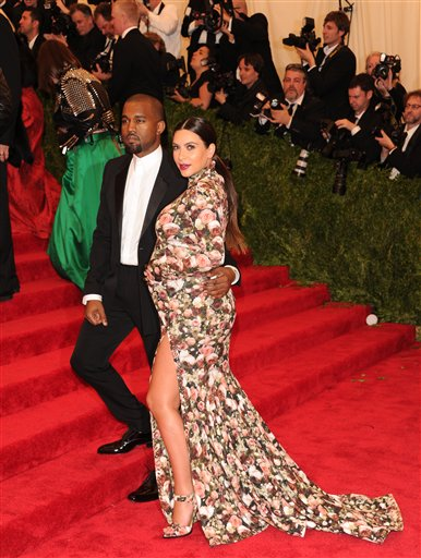 "<div class=""meta image-caption""><div class=""origin-logo origin-image ap""><span>AP</span></div><span class=""caption-text"">Kim Kardashian Kanye West attend The Metropolitan Museum of Art  Costume Institute gala benefit, ""Punk: Chaos to Couture"", on Monday, May 6, 2013   (Evan Agostini/Invision/AP) (Evan Agostini/Invision/AP)</span></div>"