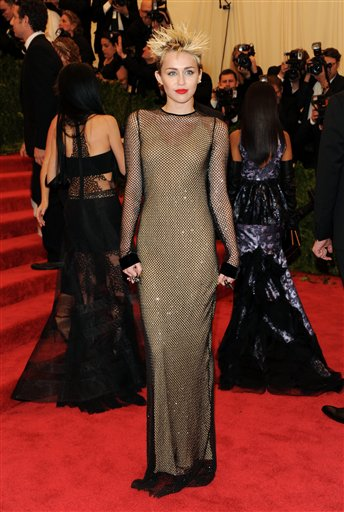 "<div class=""meta image-caption""><div class=""origin-logo origin-image ap""><span>AP</span></div><span class=""caption-text"">Singer Miley Cyrus attends The Metropolitan Museum of Art  Costume Institute gala benefit, on Monday, May 6, 2013 in New York. (Evan Agostini/Invision/AP)</span></div>"