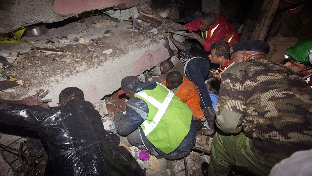 Rescue personnel search for survivors at the site of a building collapse in Nairobi, Kenya