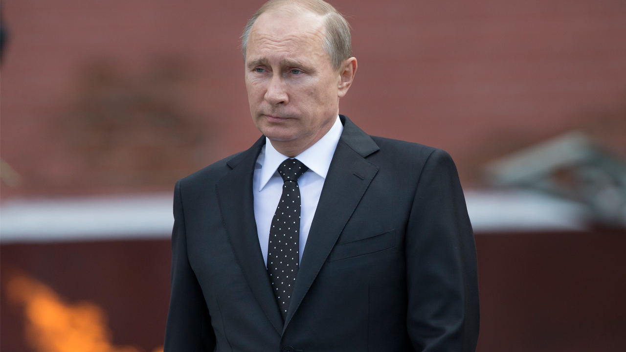 Russian Vladimir Putin takes part in a wreath laying ceremony at the Tomb of the Unknown Soldier outside Moscow's Kremlin Wall, in Moscow, Russia, Sunday, June 22, 2014.