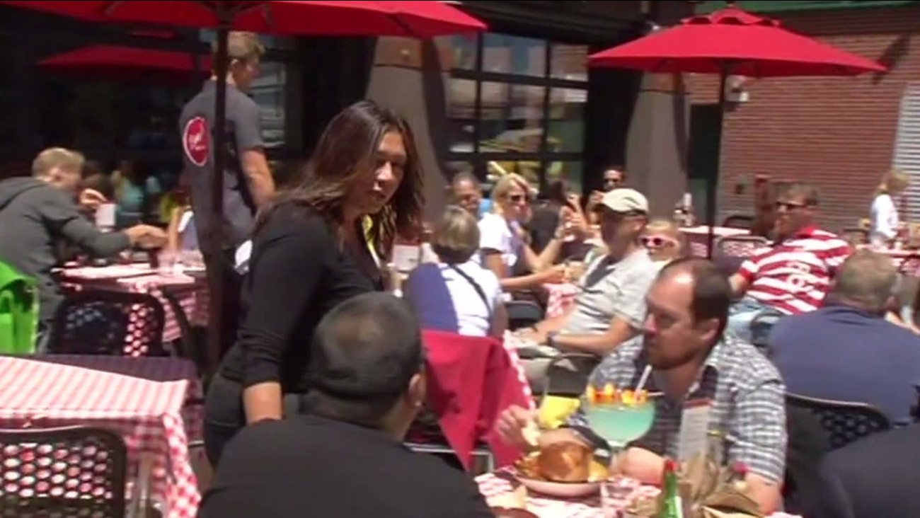 People dining on a restaurant patio.