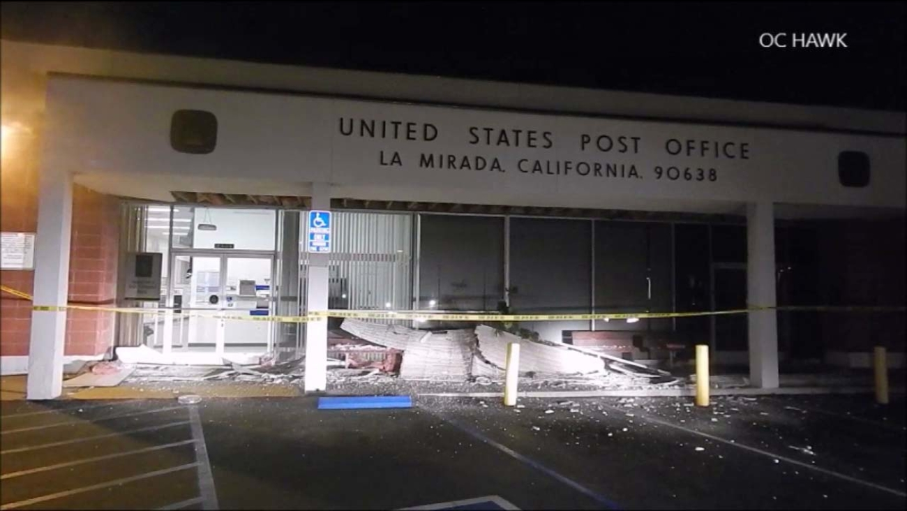 Part of the front awning at the La Mirada Post Office collapsed Tuesday, May 3, 2016, just a few seconds after a man had dropped off his mail.