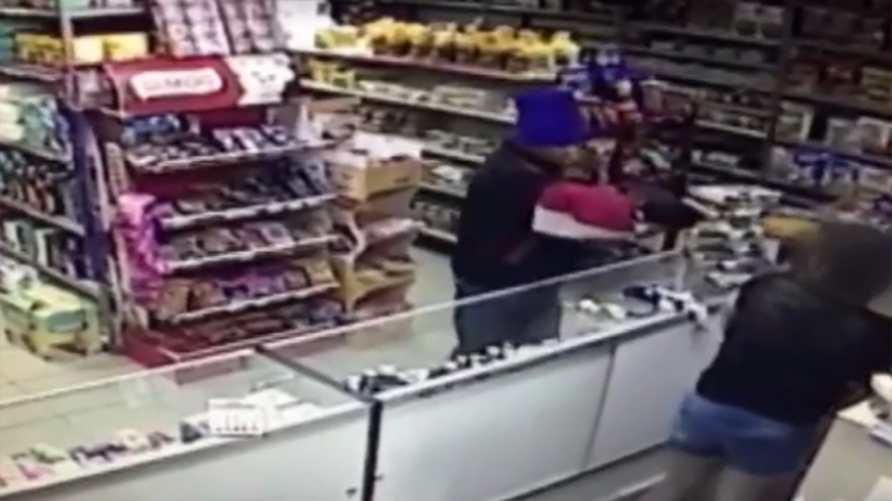 A robber pointed a gun at a store clerk holding her baby