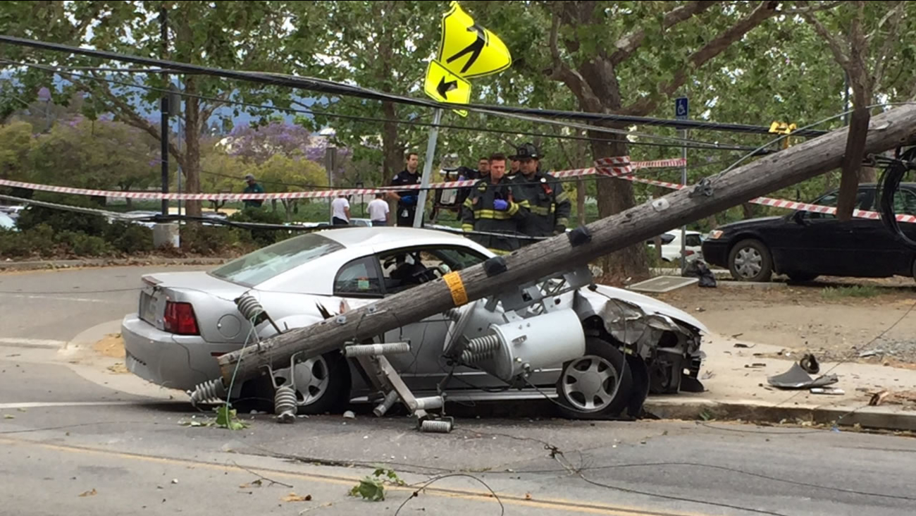 A woman was rescued from her car in San Jose, Calif. after she crashed into a power pole that had live wires on May 5, 2016.