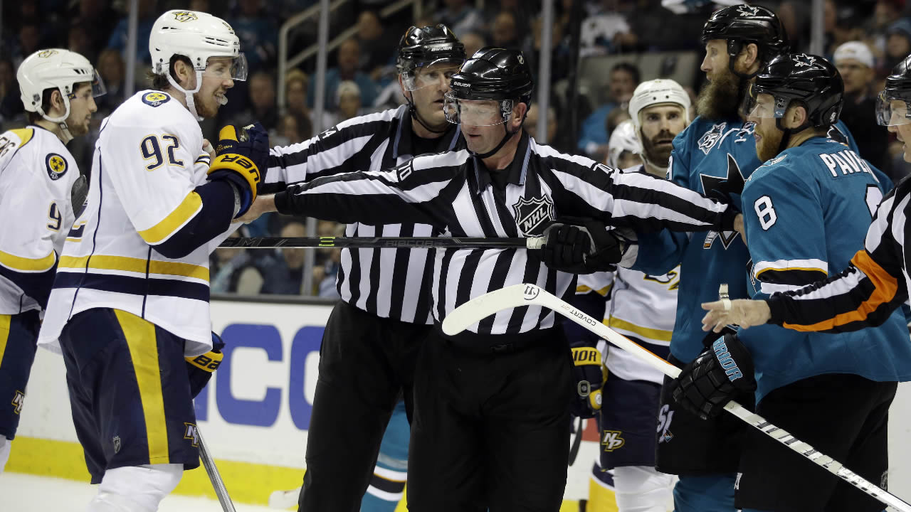 Nashville Predators' Ryan Johansen is separated from San Jose Sharks' Joe Thornton and Joe Pavelski during Game 5 in an NHL hockey Stanley Cup Western Conference semifinal series Saturday, May 7, 2016, in San Jose, Calif.