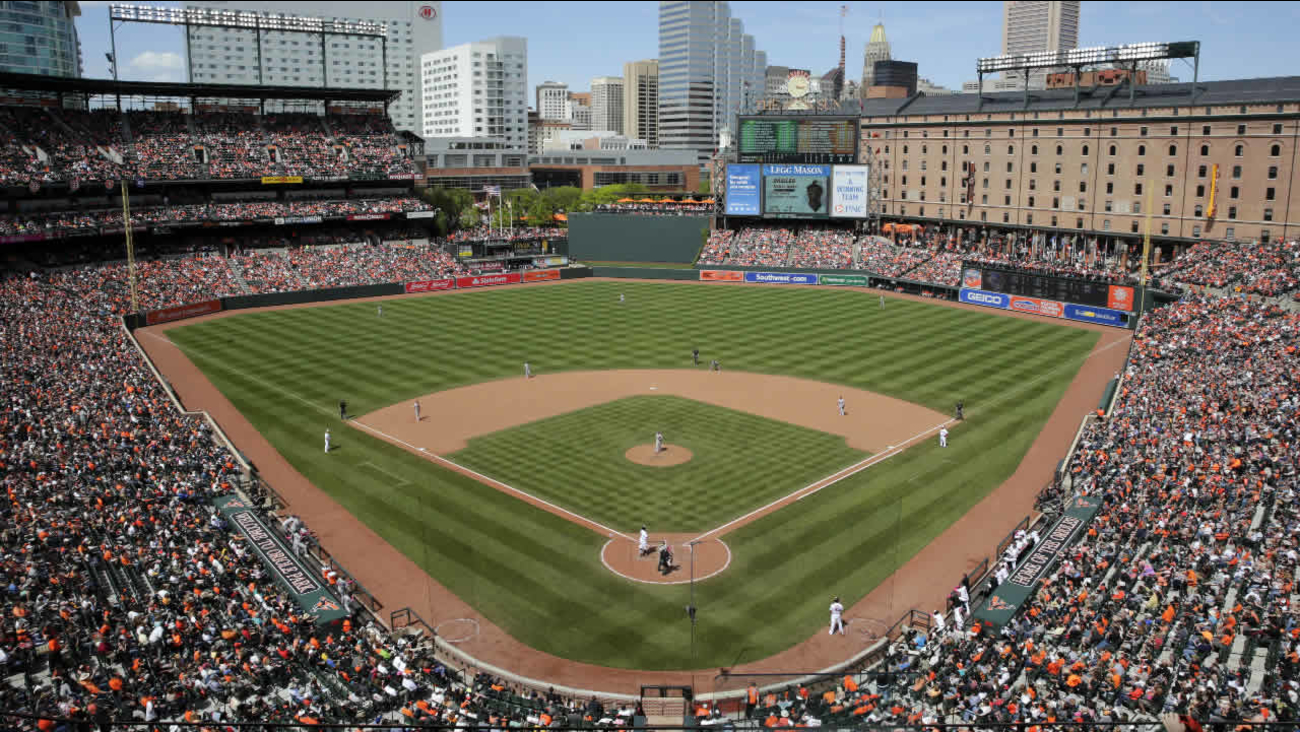 Fans watch a baseball game between the Baltimore Orioles and the Oakland Athletics in Baltimore, Sunday, May 8, 2016.