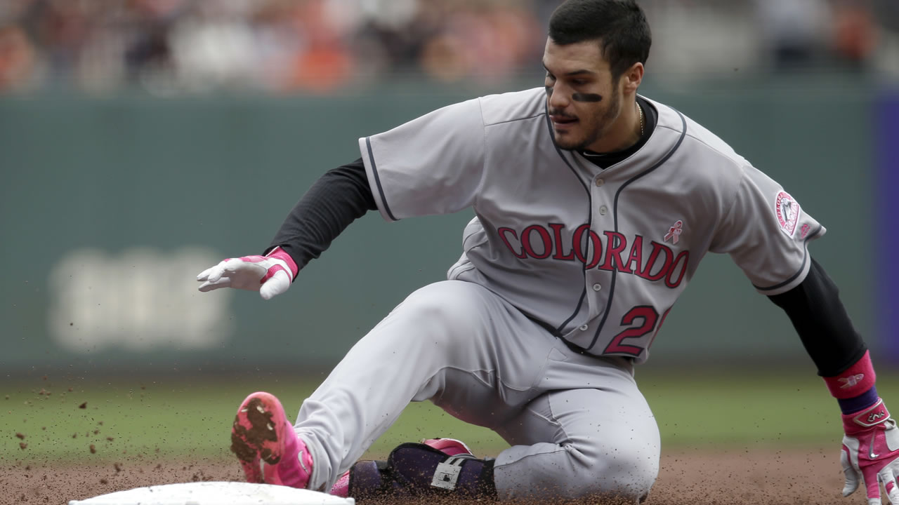 Rockies' Nolan Arenado (28) slides safely into third base with an RBI-triple during a game against the Giants on Sunday, May 8, 2016. (AP Photo/Marcio Jose Sanchez)