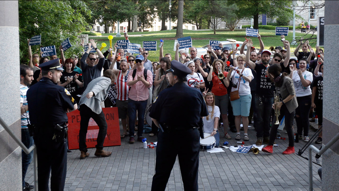 Protesters gather outside the the North Carolina Museum of History as Gov. Pat McCrory make remarks about House Bill 2 during in Raleigh, N.C., Wednesday, May 4, 2016.