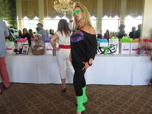 <div class='meta'><div class='origin-logo' data-origin='none'></div><span class='caption-text' data-credit=''>Guests dressed in 80's costumes at Goodwill Gala 2016</span></div>