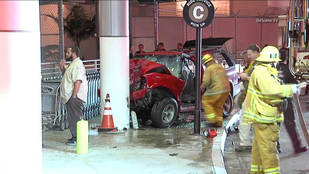 Firefighters work the scene of a car crash at Los Angeles International Airport on Monday, May 9, 2016.