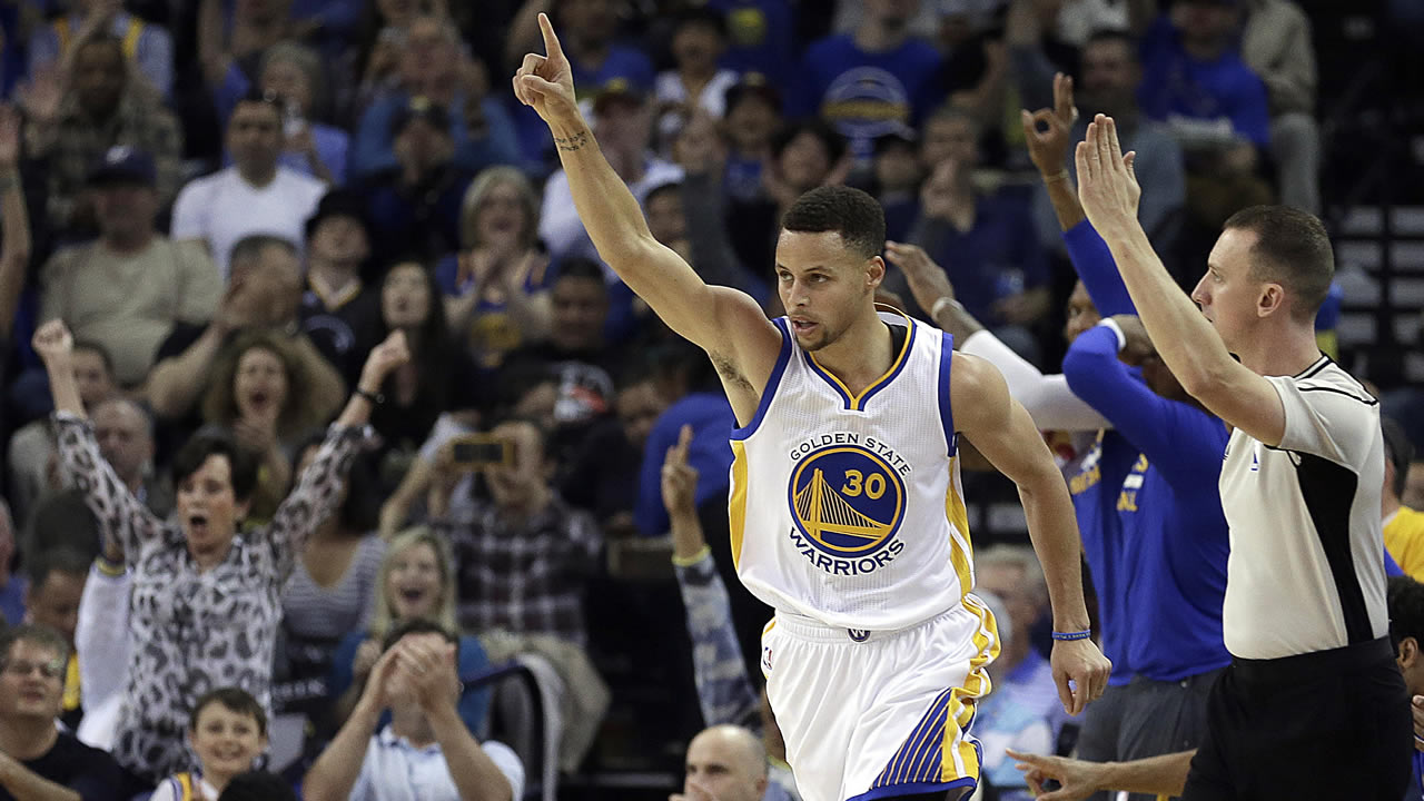 FILE - In this April 3, 2016, Warriors' Stephen Curry celebrates a score during a basketball game against the Trail Blazers in Oakland, Calif. (AP Photo/Ben Margot, File)