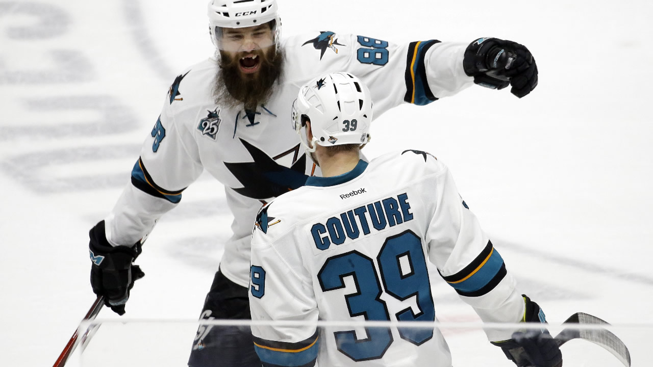 San Jose Sharks center Logan Couture (39) is congratulated by Brent Burns (88) after Couture scored a goal against the Nashville Predators in Game 6 of the Stanley Cup Western Conference semifinal playoff series, Monday, May 9, 2016, in Nashville, Tenn.