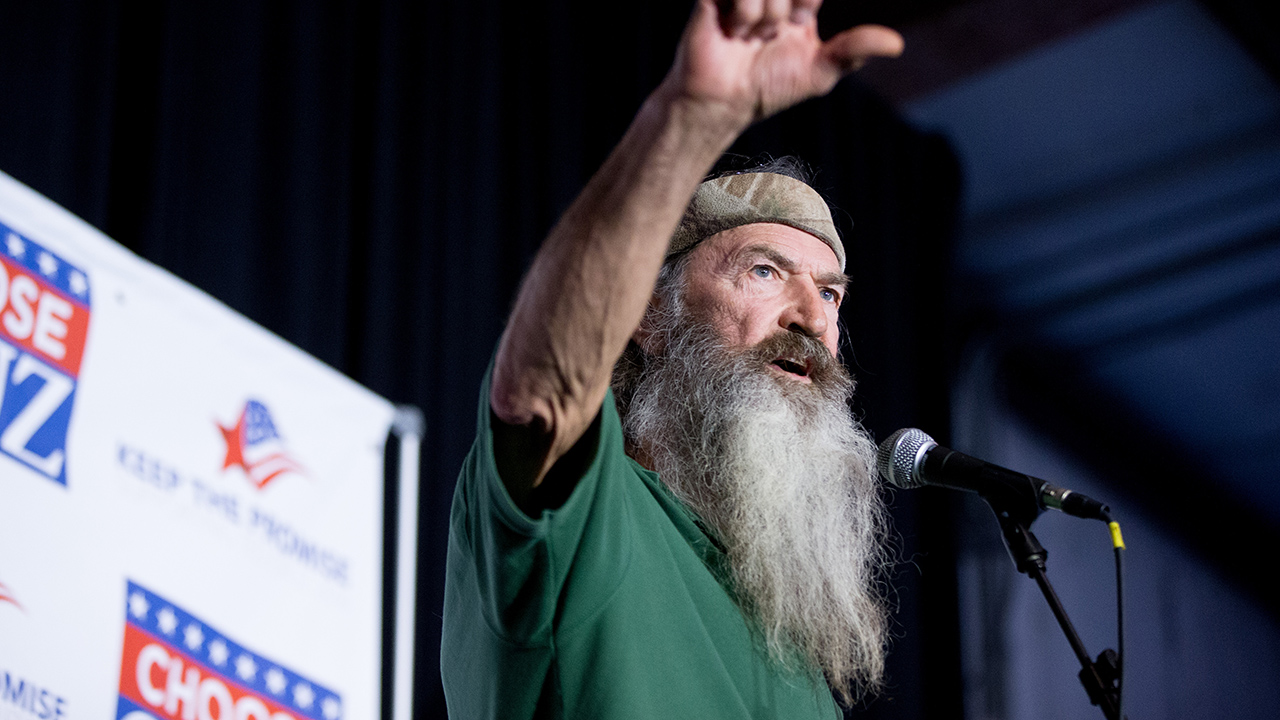 Phil Robertson of the Duck Dynasty reality television program speaks at a rally for Republican presidential candidate, Sen. Ted Cruz, R-Texas, at Eagle Aviation Hangar in Columbia