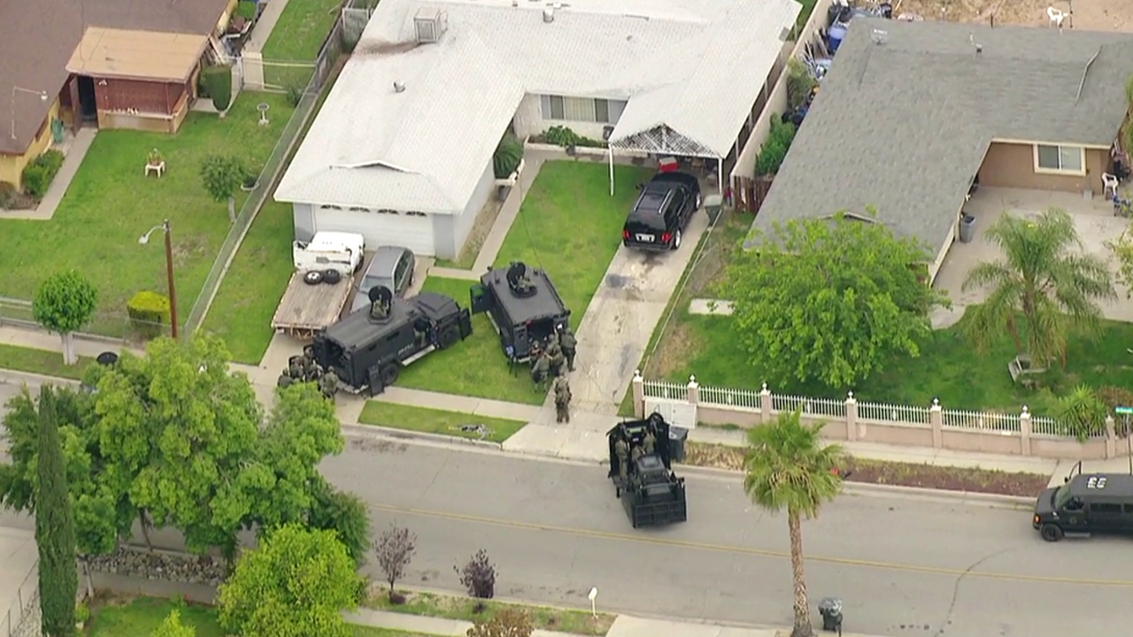 SWAT personnel respond to a barricade situation in the 2200 block of Donald Street in San Bernardino Tuesday, May 10, 2016.