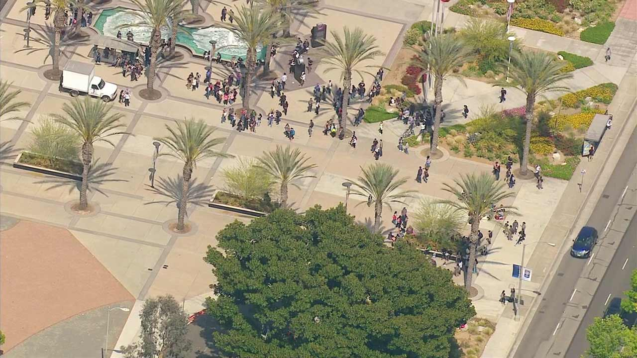 People are seen on the Cal State Fullerton campus after McCarthy Hall was evacuated due to a suspicious package on Tuesday, May 10, 2016.