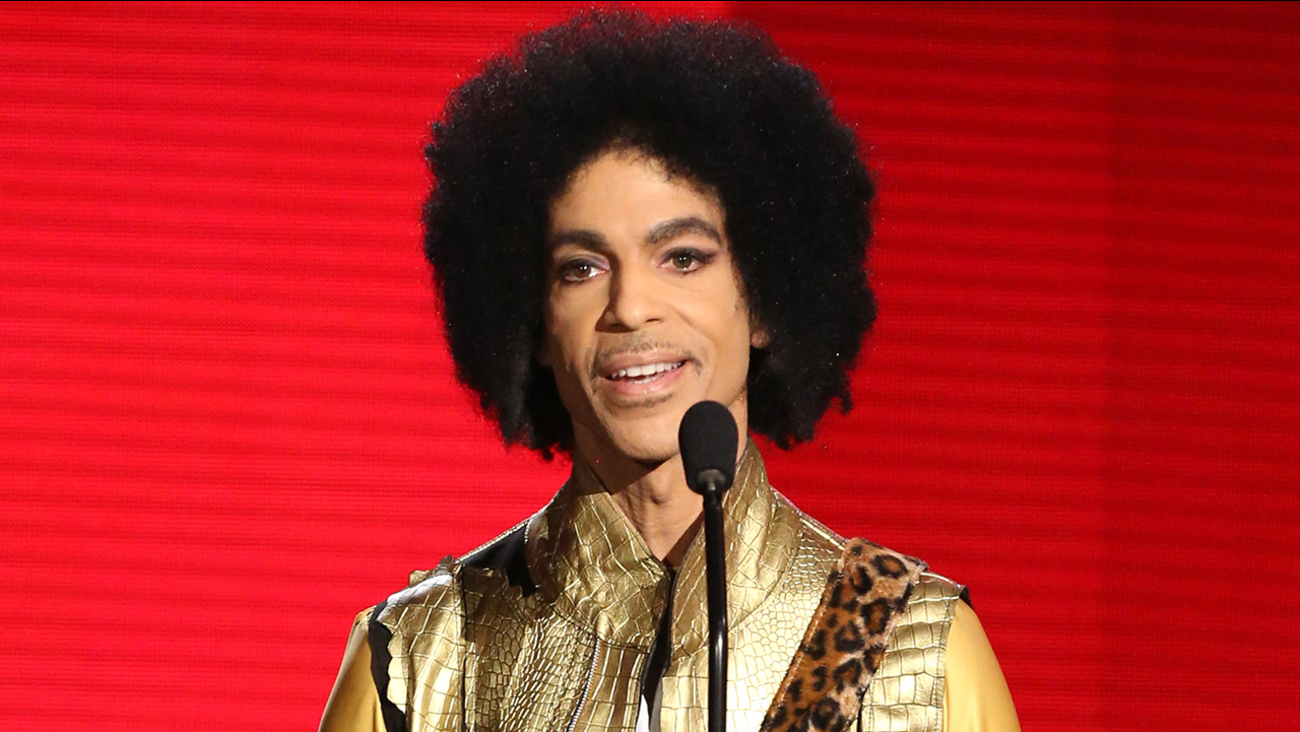 In this Nov. 22, 2015 file photo, Prince presents an award at the American Music Awards in Los Angeles.