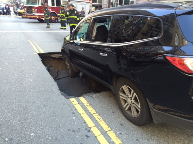 "<div class=""meta image-caption""><div class=""origin-logo origin-image none""><span>none</span></div><span class=""caption-text"">Crews rescued a family inside a  car that got stuck in a large sinkhole in downtown San Francisco, on Tuesday, May 10, 2016. (KGO-TV)</span></div>"