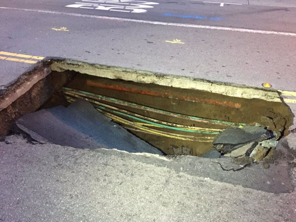 "<div class=""meta image-caption""><div class=""origin-logo origin-image none""><span>none</span></div><span class=""caption-text"">This image a shows a sinkhole in downtown San Francisco on May 10, 2016. (KGO-TV)</span></div>"