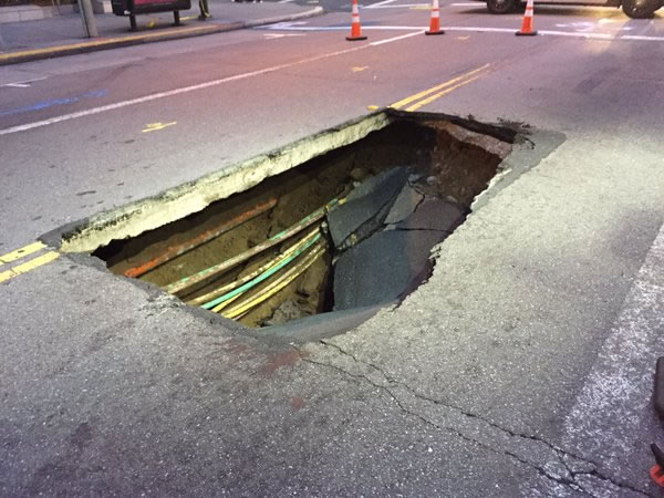 "<div class=""meta image-caption""><div class=""origin-logo origin-image none""><span>none</span></div><span class=""caption-text"">This image shows a sinkhole that opened in downtown San Francisco on May 10, 2016. (KGO-TV)</span></div>"