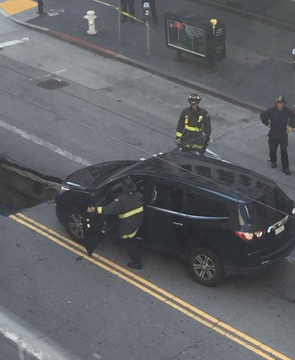 "<div class=""meta image-caption""><div class=""origin-logo origin-image none""><span>none</span></div><span class=""caption-text"">This image shows a car that nearly got trapped inside a sinkhole after it opened in downtown San Francisco May 10, 2016. (Submitted to KGO-TV via Twitter by @AhrensDavid)</span></div>"