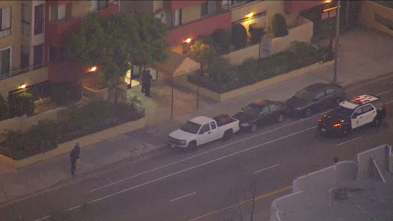 Authorities investigate the scene of an armed robbery and shooting in North Hollywood on Thursday, May 12, 2016.