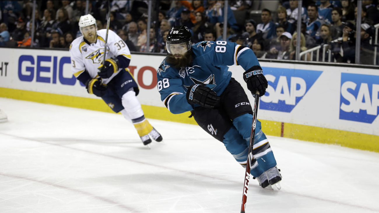 San Jose Sharks' Brent Burns (88) skates in front of Nashville Predators' Colin Wilson (33) during Game 7 in an NHL hockey Stanley Cup Thursday, May 12, 2016 in San Jose, Calif.