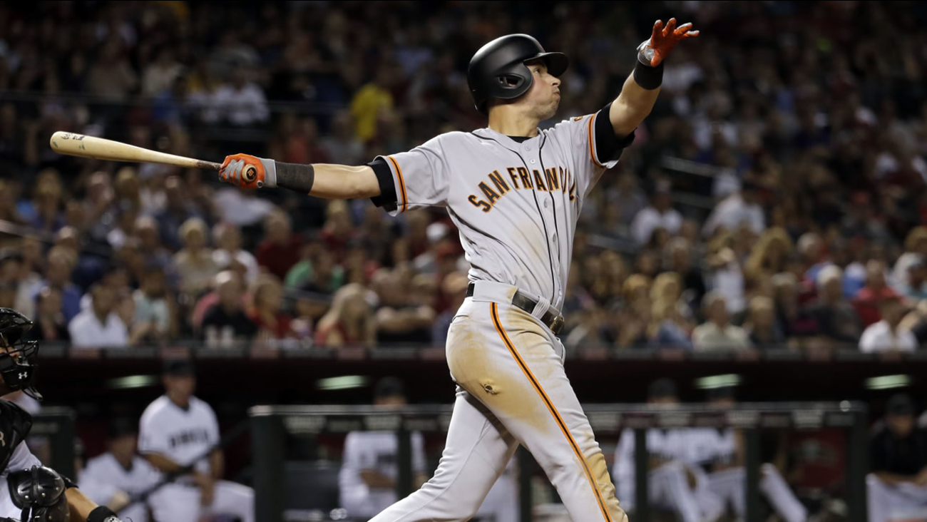 San Francisco Giants' Joe Panik watches his three-run home run take flight against the Arizona Diamondbacks during the sixth inning of a baseball game, Friday, May 13, 2016.