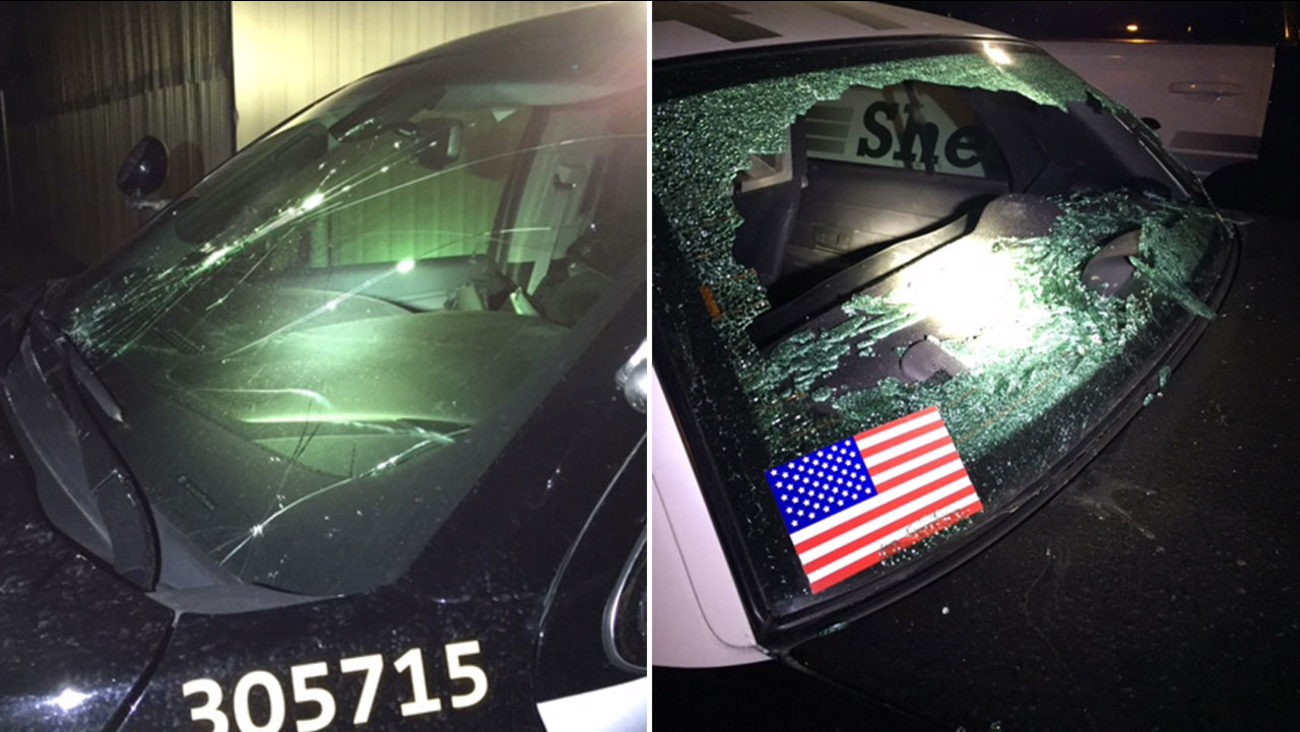 Two Ventura County sheriff's deputies patrol cars are shown with damage sustained by a suspect who threw rocks at the cars on May 7, 2016.