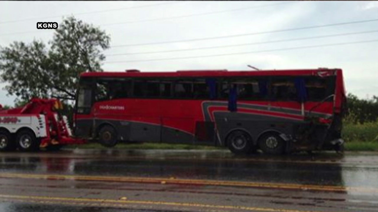 A charter bus is towed after a crash killed 8 people and injured at least 40 north of Laredo, Texas.