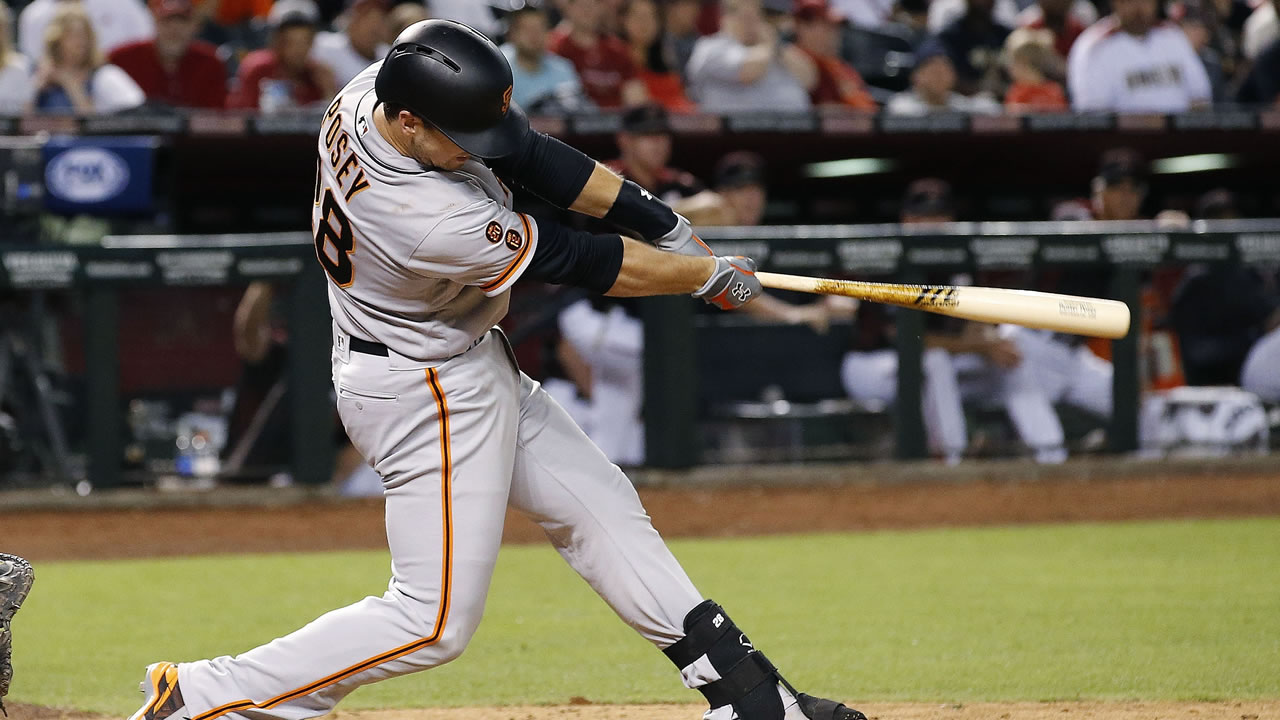 San Francisco Giants' Buster Posey connects for a two-run double against the Arizona Diamondbacks during the ninth inning of a baseball game Saturday, May 14, 2016, in Phoenix.